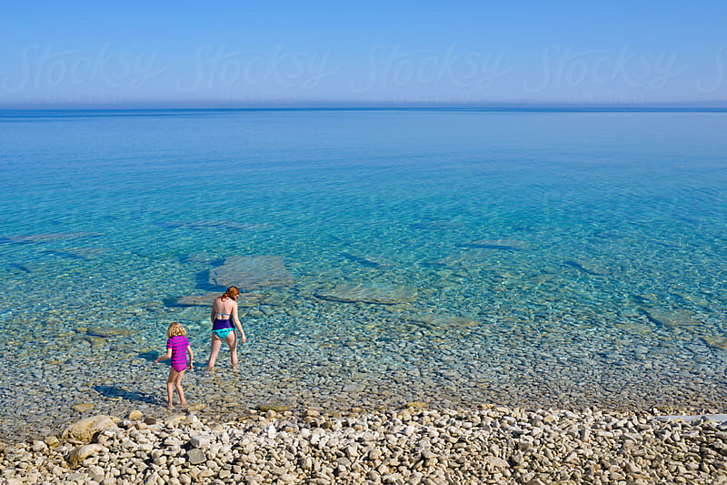 Mother and Daughter Goring For Swim Backcountry Camping at High Dump Bruce Peninsula National Park by JP Danko for Stocksy United