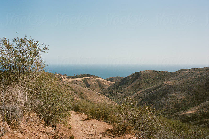 A Hike through Mountains near the Ocean Shot on Film by Rachel Gulotta Photography for Stocksy United