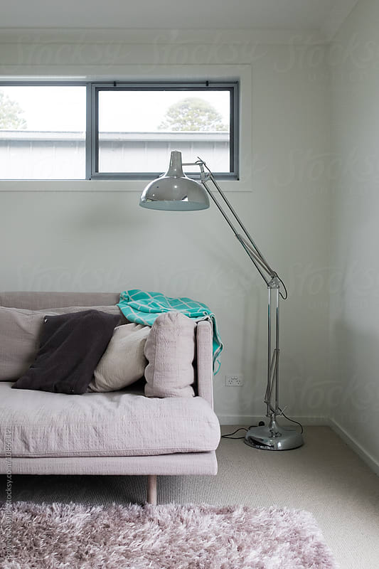 Plush lounge with lamp stand and rug by Rowena Naylor for Stocksy United