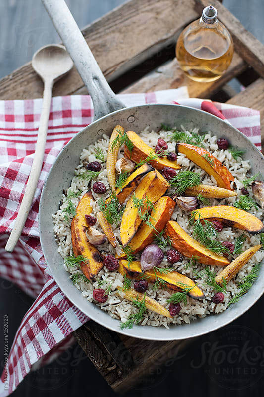 Food: Fried Rice with Grilled Pumpkin, Cranberries, Corn  by Ina Peters for Stocksy United