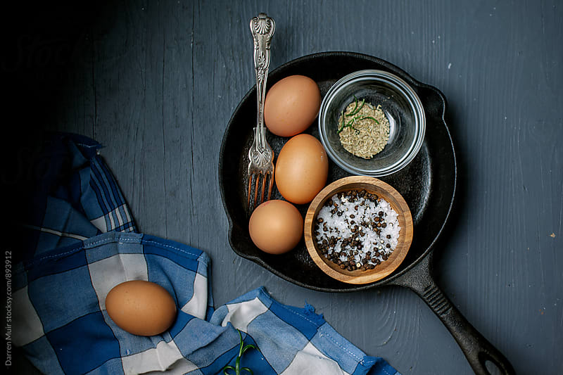 Eggs in a frying pan. by Darren Muir for Stocksy United
