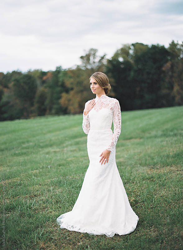 Bride in modern lace wedding dress by Vicki Grafton Photography for Stocksy United