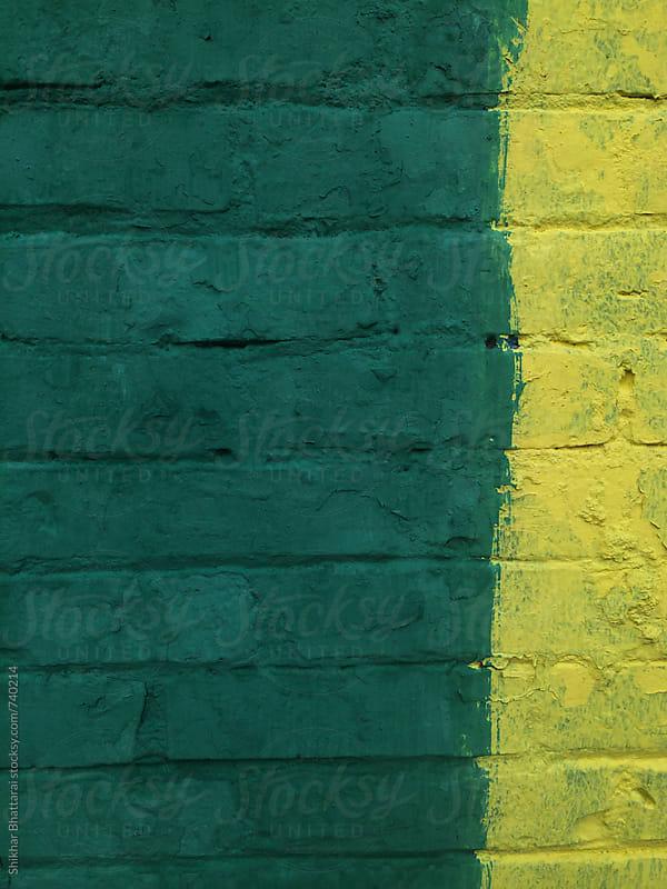Urban background, green and yellow painted brick walls. by Shikhar Bhattarai for Stocksy United