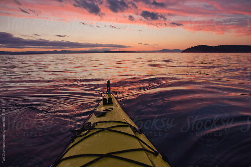 Kayak on water at sunset by Tari Gunstone for Stocksy United