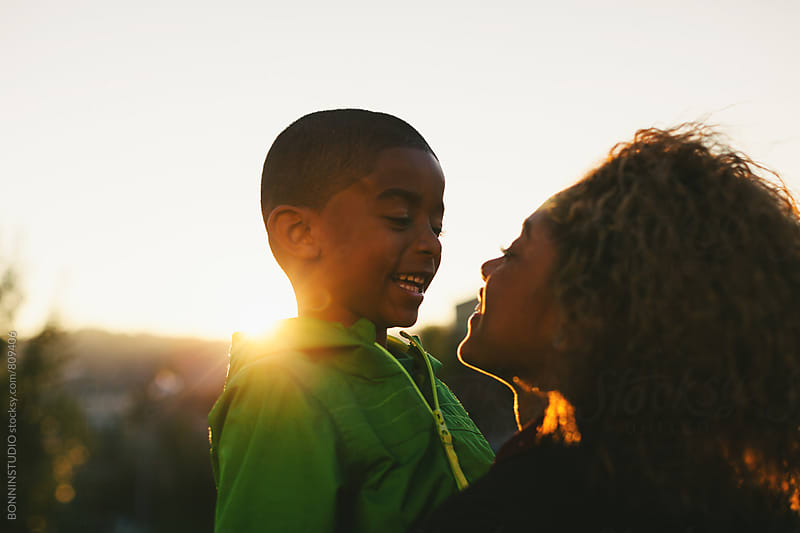 Mother and her son in the park at sunset. by BONNINSTUDIO for Stocksy United