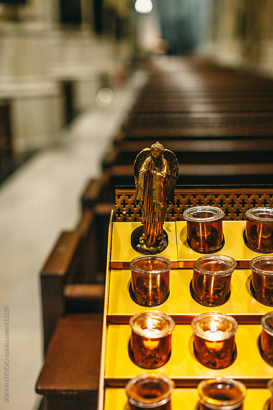 Candles in a church. by BONNINSTUDIO for Stocksy United