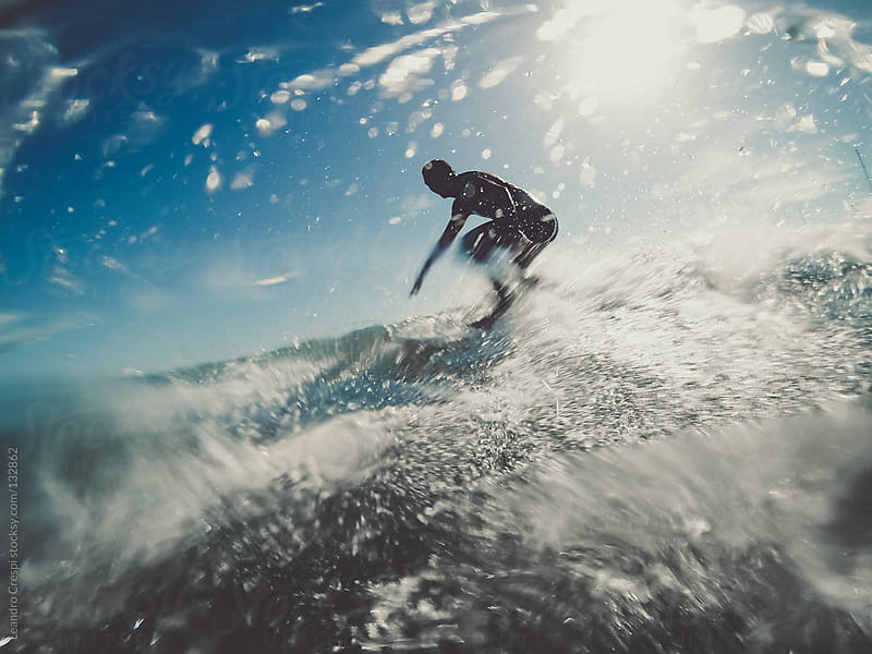 surfer riding wave by Leandro Crespi for Stocksy United