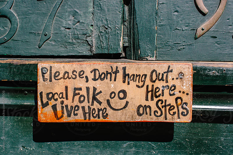 no loitering sign in New Orleans by Kristen Curette Hines for Stocksy United