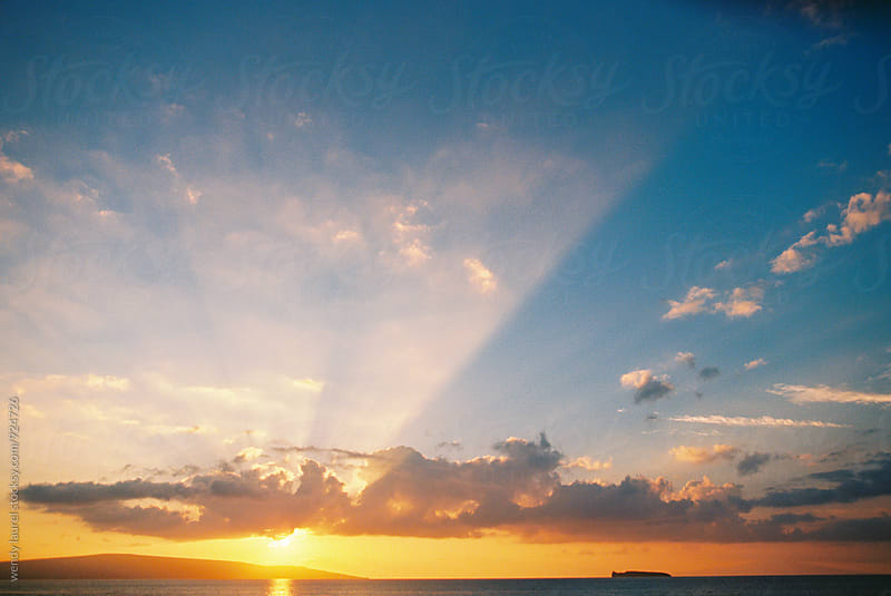 sunset over ocean with light rays by wendy laurel for Stocksy United