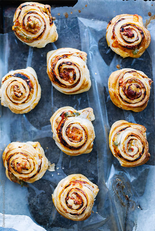 Cheese and tomato pastry wheels.  by Darren Muir for Stocksy United