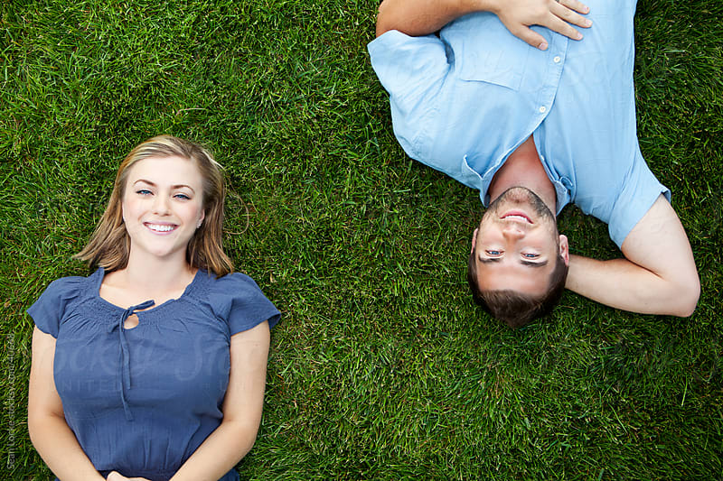 Grass: Couple on Grass Looks Up by Sean Locke for Stocksy United