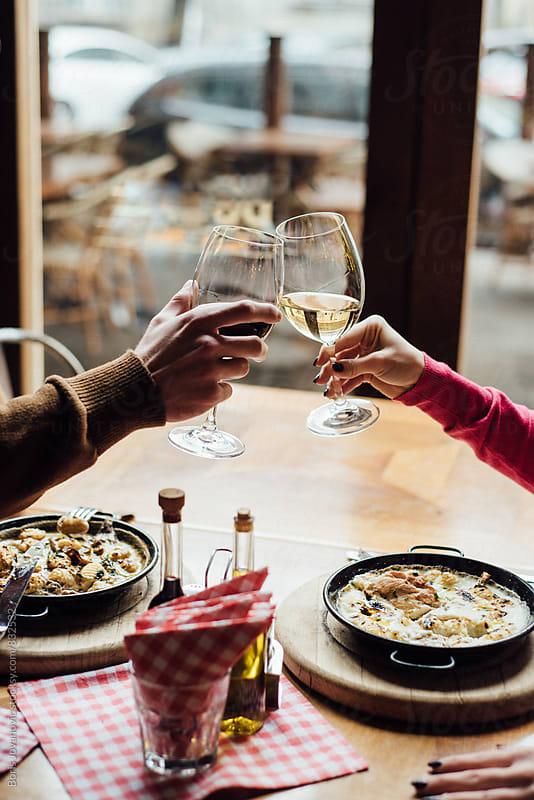 Couple having a toast  by Boris Jovanovic for Stocksy United