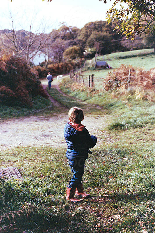 Small child looking down  the lane by Andrew Spencer for Stocksy United