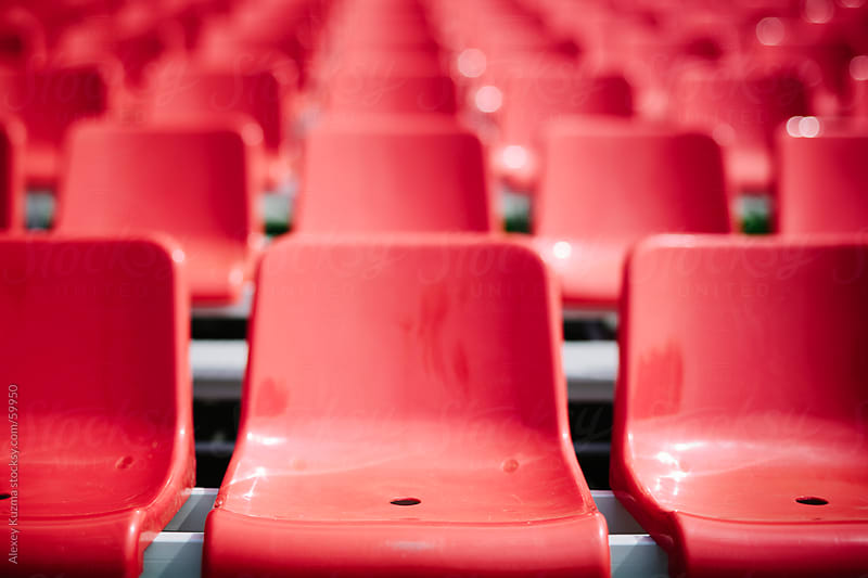red seats by Alexey Kuzma for Stocksy United