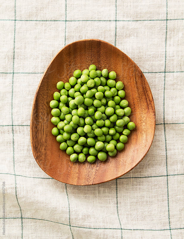 Green Peas in a wooden bowl on plaid Linen by Naoko Kakuta for Stocksy United