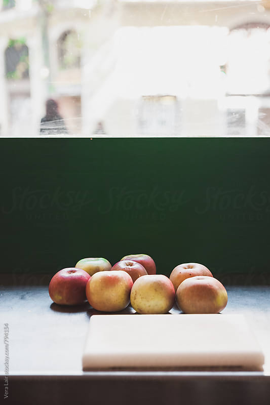 Apples and cutting board by Vera Lair for Stocksy United