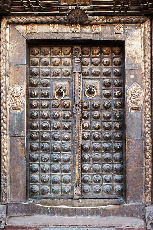 Ancient intricate metal door of a palace in Kathmandu. by Shikhar Bhattarai for Stocksy United