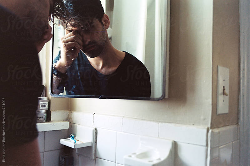 Man in Mirror by Brad and Jen Butcher for Stocksy United