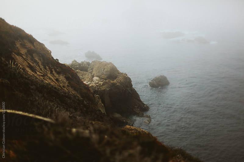 Foggy Cliffs  by Christian Gideon for Stocksy United