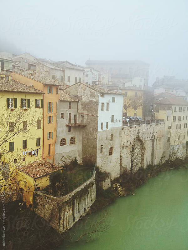 Group of typical houses overlooking a river in a small town in central Italy by michela ravasio for Stocksy United