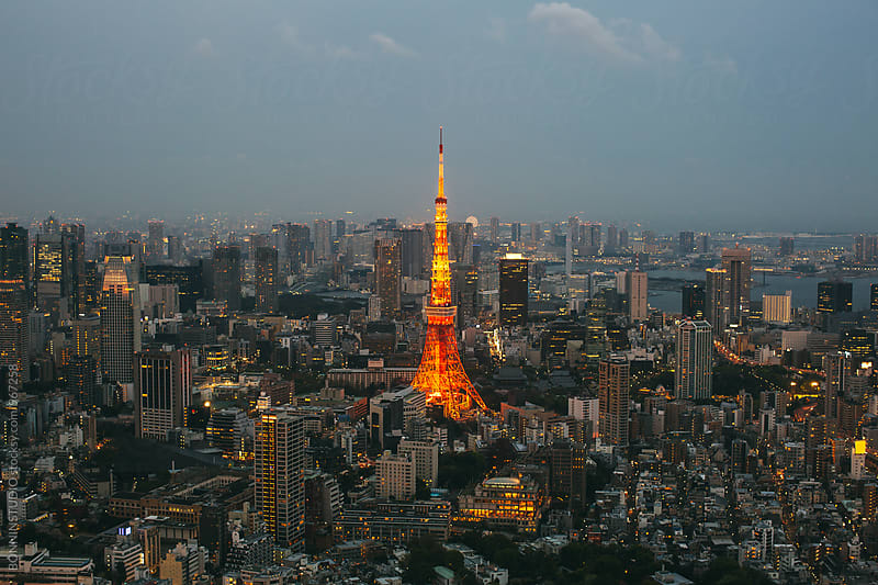 Tokyo skyline at sunset. by BONNINSTUDIO for Stocksy United
