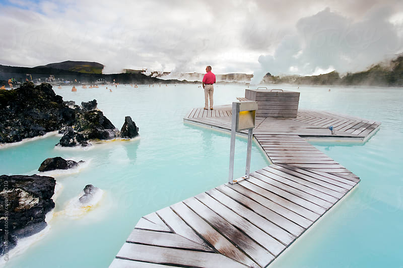 Water rich in blue-green algae (cyanobacteria), mineral salts and fine silica mud at the geothermal spa that owes its existence to the Svartsengi geothermal power plant, Blue Lagoon, near Reykjavik, Iceland, Polar Regions  by Gavin Hellier for Stocksy United