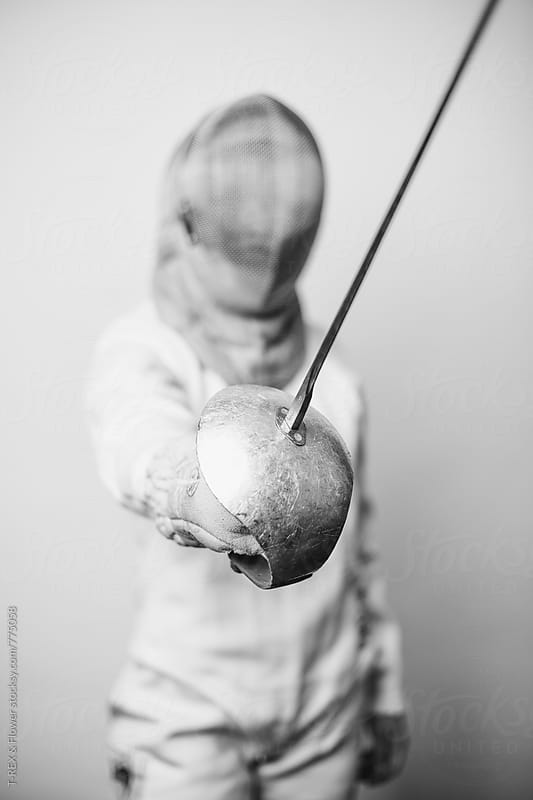 Professional fencing athlete holding sabre by T-REX & Flower for Stocksy United