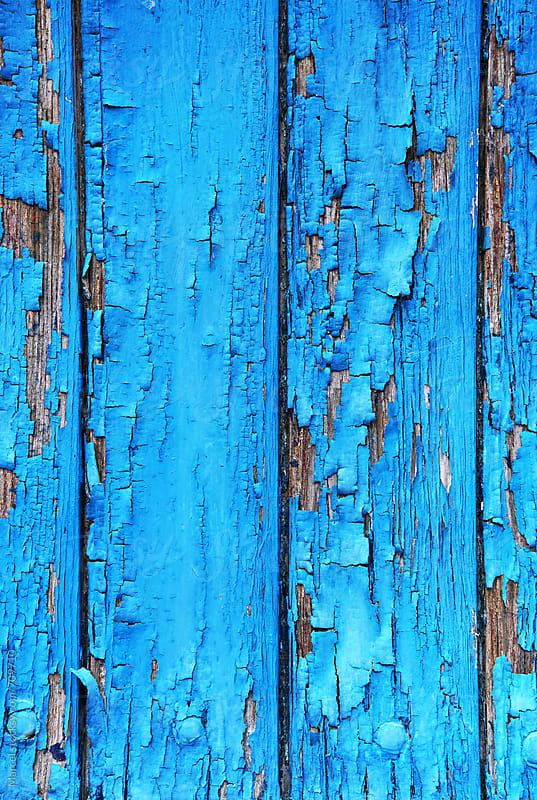 Cracking blue paint on an old door by Marcel for Stocksy United