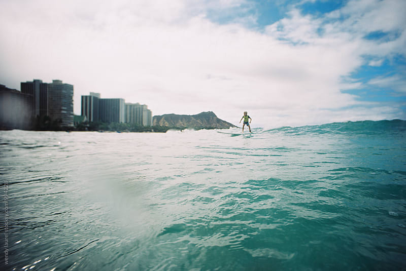 boy surfer at waikiki beach by wendy laurel for Stocksy United