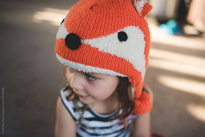Girl wearing fox hat  by Courtney Rust for Stocksy United