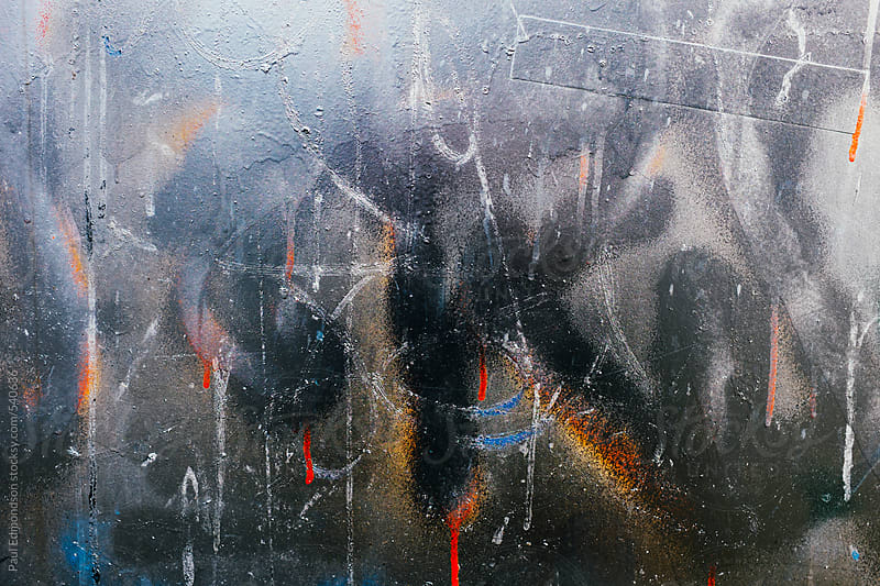 Metallic paint and graffiti markings on building wall, close up by Paul Edmondson for Stocksy United