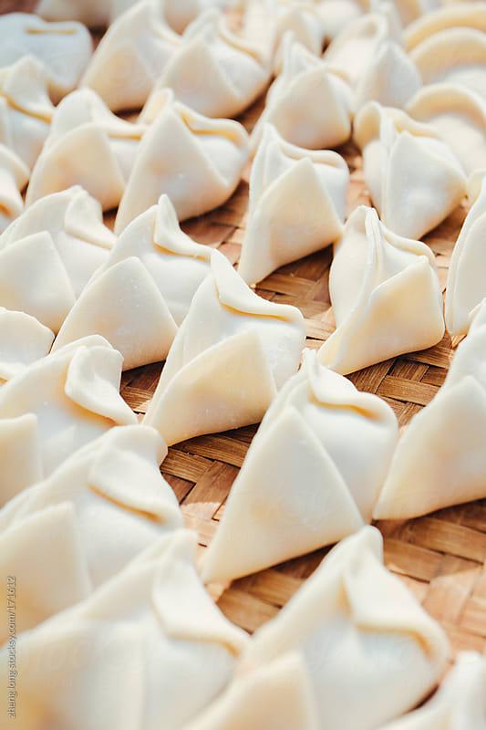 Making dumplings,to celebrate the Spring Festival by zheng long for Stocksy United
