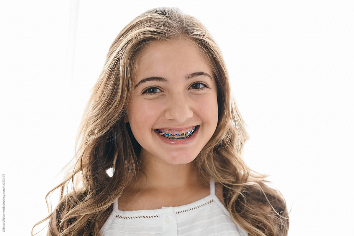 Smiling Beautiful Pre-Teen With Braces  Stocksy United-9629