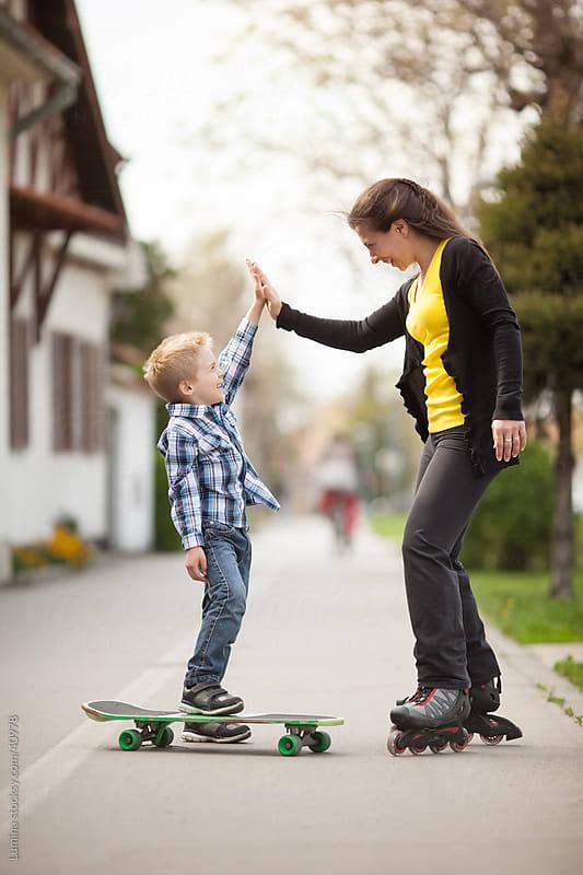 Skateboarding High Five by Lumina for Stocksy United