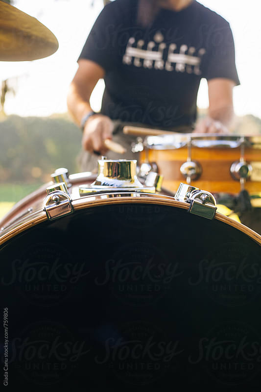 Drummer playing in nature by Giada Canu for Stocksy United