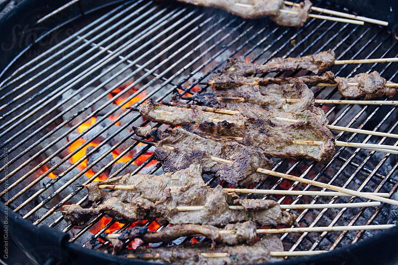 Beef satay on a charcoal grill by Gabriel (Gabi) Bucataru for Stocksy United