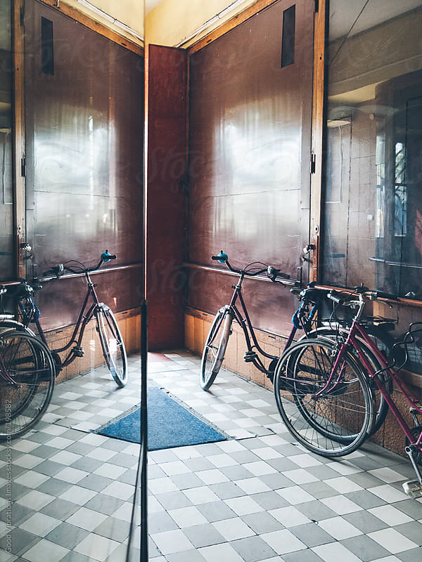 Bicycles in the Entrance Hall by Good Vibrations Images for Stocksy United