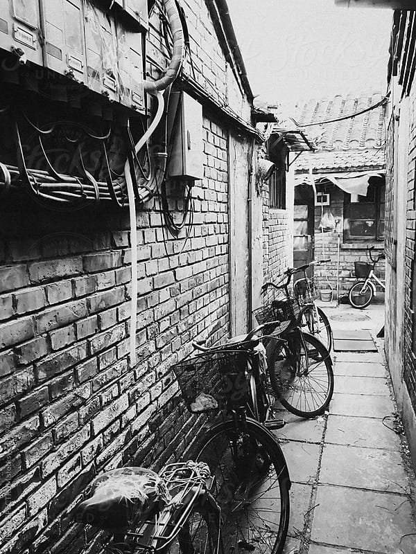 Bicycles Standing in Old Beijing Alley by Julien L. Balmer for Stocksy United