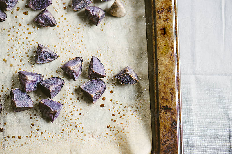 Roasted Purple Potatoes by Cameron Whitman for Stocksy United