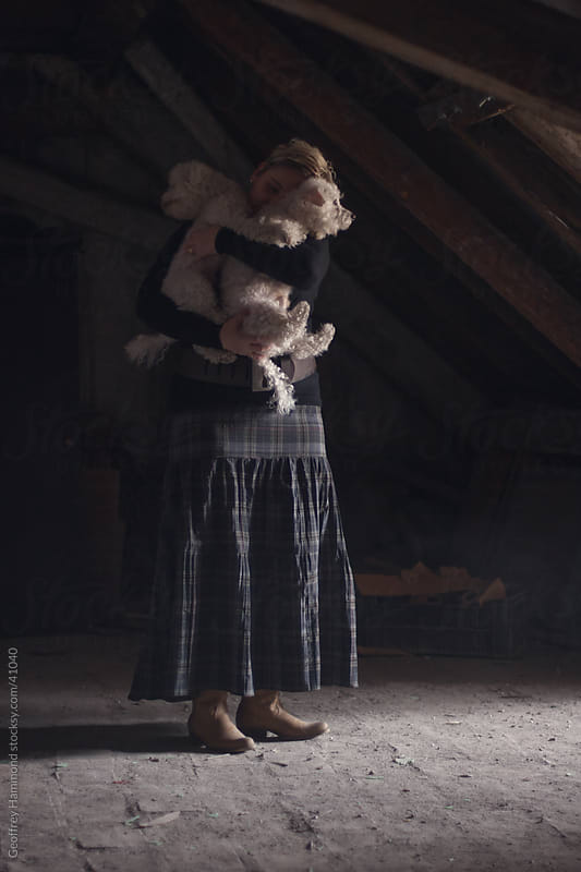 Woman in Attic with Bichon Dogs by Geoffrey Hammond for Stocksy United