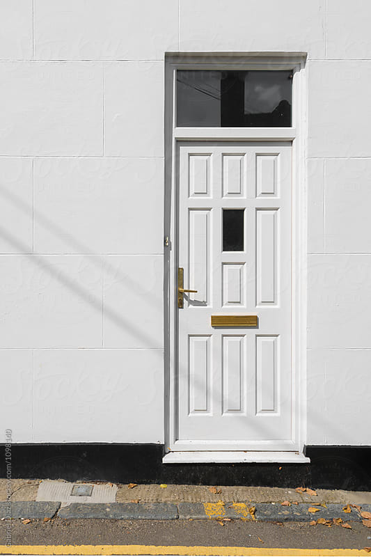 White Front door by Gabriel Diaz for Stocksy United