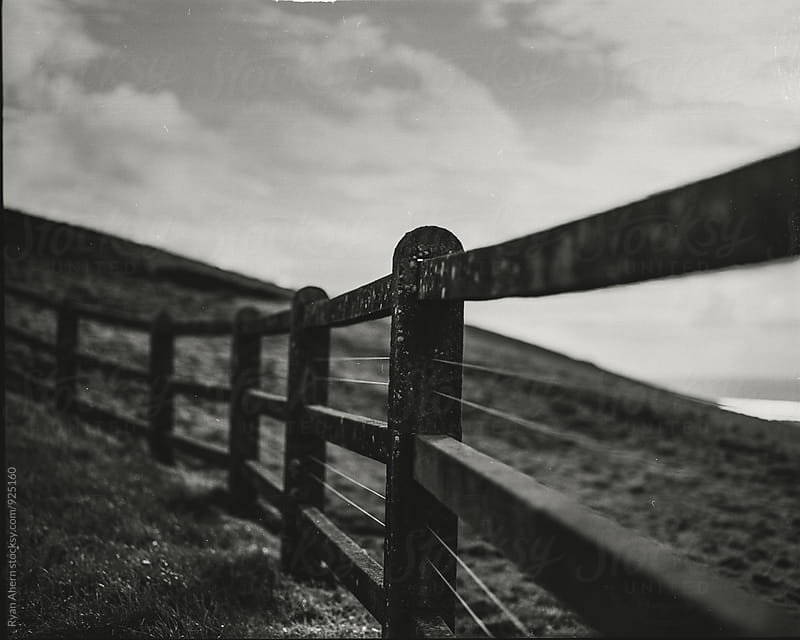 Fence on the Cliff by Ryan Ahern for Stocksy United