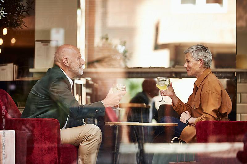 Senior Couple Enjoying Drinks In Restaurant by ALTO IMAGES for Stocksy United