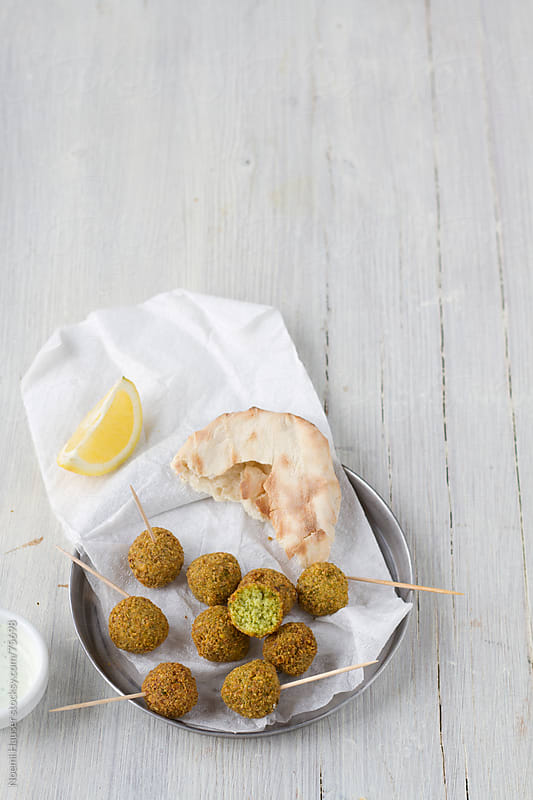 Falafel with pita by Noemi Hauser for Stocksy United