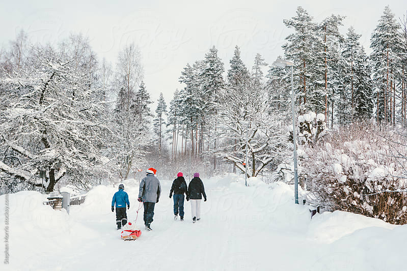 Family Walking in the Snow by Stephen Morris for Stocksy United