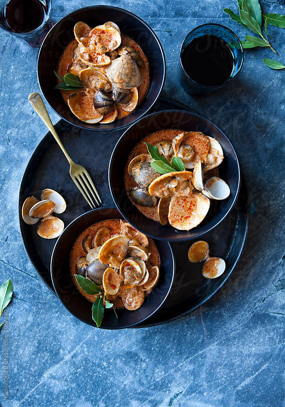 Overhead view of clam curry by Nadine Greeff for Stocksy United
