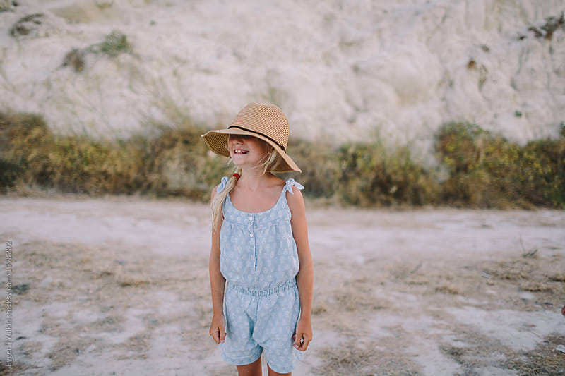 Little girl and hat  by Evgenij Yulkin for Stocksy United