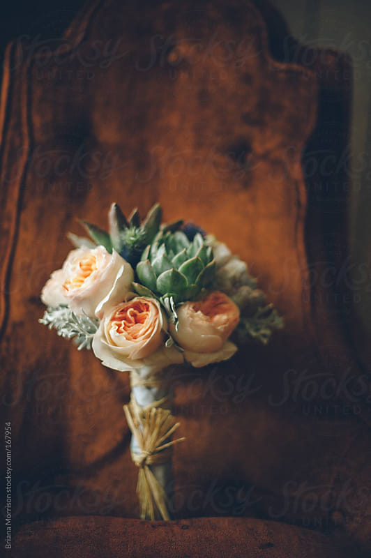 Wedding Bouquet with Peonies and Succulents on a Vintage Chair by Briana Morrison for Stocksy United