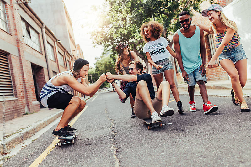 Group of young people on the city street by Jacob Lund for Stocksy United