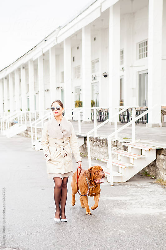 Young lady having walk with her pet . by Audrey Shtecinjo for Stocksy United